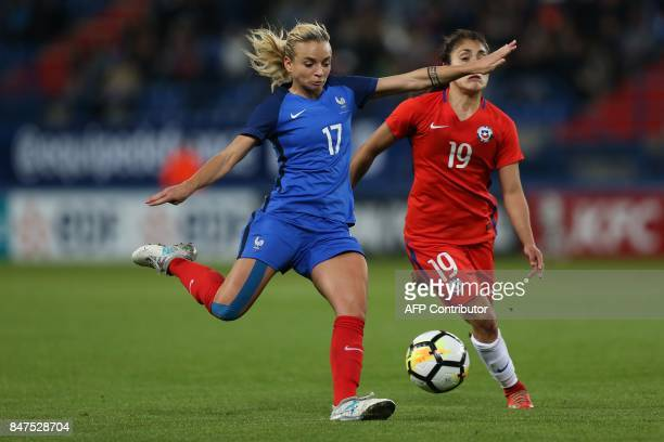 France's Marion Torrent vies with Chile's Yessenia Huenteo during a friendly football match between France and Chile at Michel D'Ornano Stadium in...