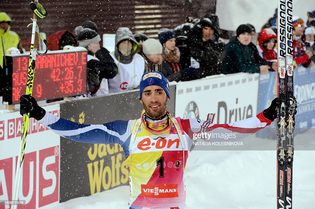 France's Martin Fourcade celebrates as he crossed the finish line in first place during the men's 15 km mass start event of the IBU Biathlon Word Cup in the Siberian city of Khanty-Mansiysk, on March 17, 2013. France's Martin Fourcade took the first place ahead of Austria's Dominik Landertinger and Norway's Emil Hegle Svendsen.