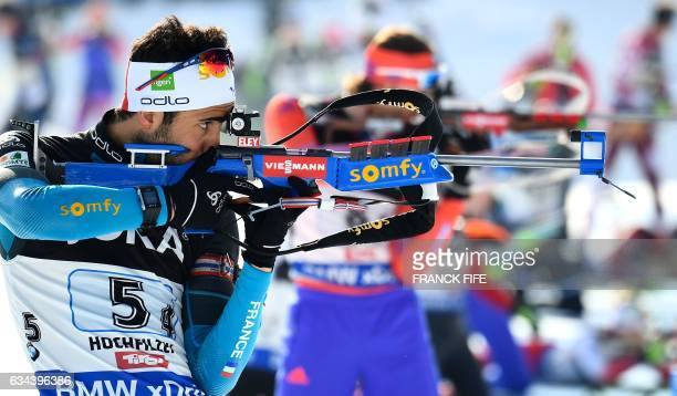 France's Martin Fourcade competes during the 2017 IBU World Championships Biathlon mixed relay race in Hochfilzen on February 09 2017 / AFP / FRANCK...