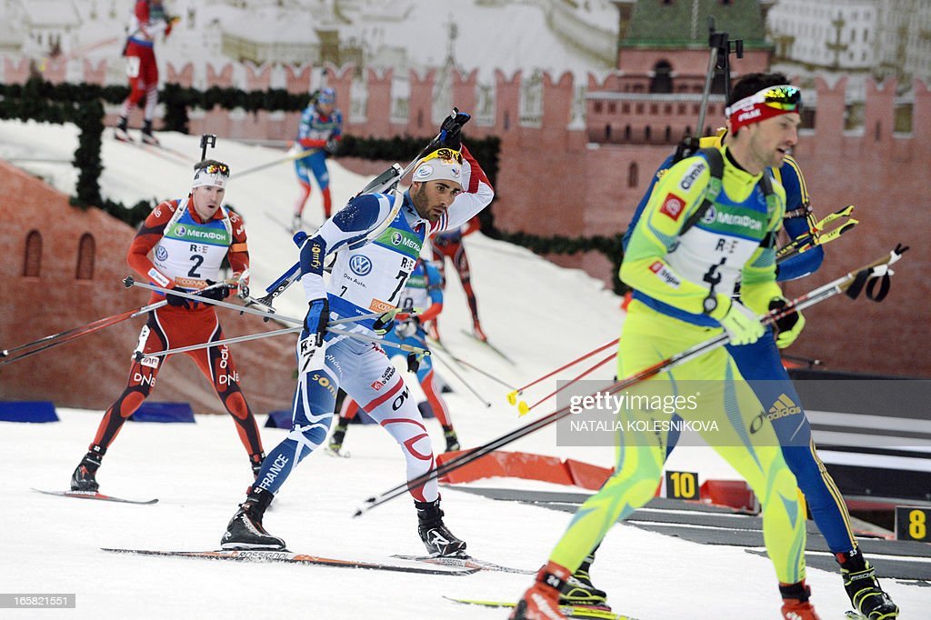 France's Martin Fourcade (C) competes on April 6, 2013 in the men's biathlon mass start during the Champion's Race in Moscow.