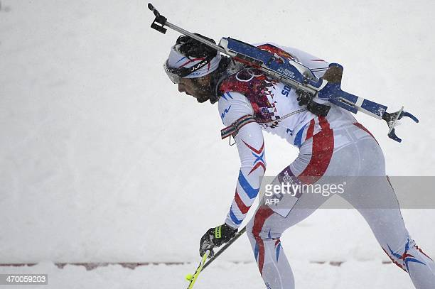 France's Martin Fourcade cross the finish line to win silver in the Men's Biathlon 15 km Mass Start at the Laura CrossCountry Ski and Biathlon Center...