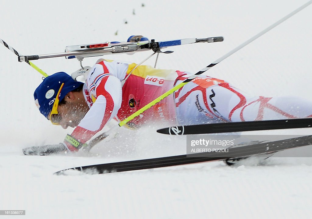 France's Martin Fourcade falls in front of the finish line during the pursuit men12,5 km as part of IBU Biathlon World Championships in Nove Mesto, Czech Republic, on February 10, 2013.