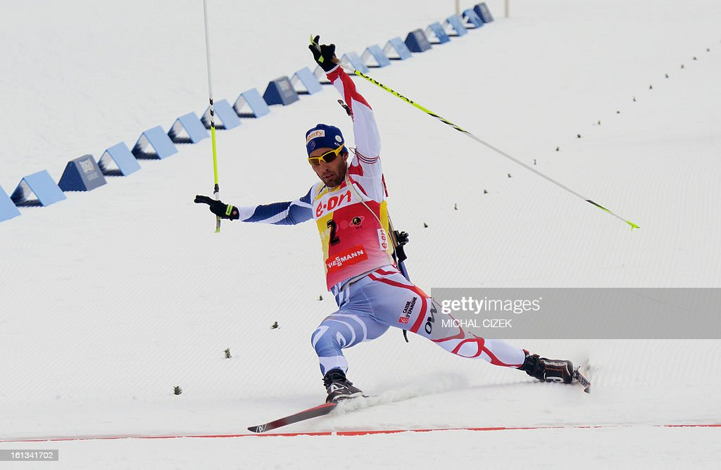 France's Martin Fourcade falls in front of the finish line during the pursuit men12,5 km as part of IBU Biathlon World Championships in Nove Mesto, Czech Republic, on February 10, 2013.Norway's Emil Hegle Svendsen won ahead of France's Martin Fourcade and Russia's Anton Shipulin.