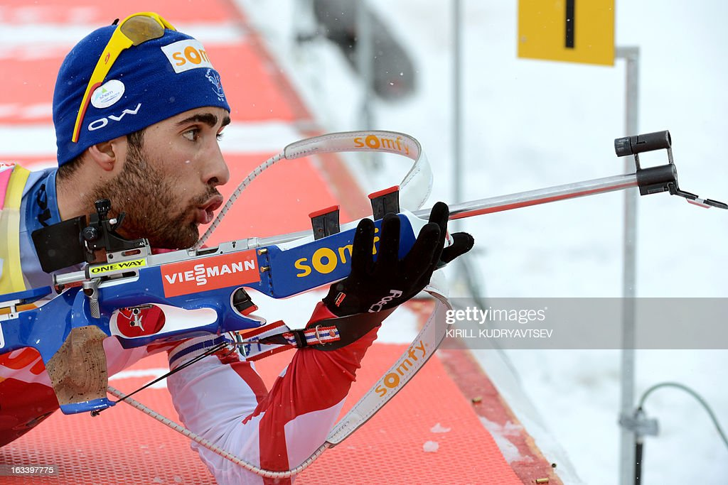 France's Martin Fourcade prepares to shoot as he competes in the Men 7,5 km Sprint during IBU World Cup Biathlon at Laura Cross Country and Biathlon Center in Russian Black Sea resort of Sochi on March 9, 2013. France's Martin Fourcade took the first place ahead of Russia's Evgeny Ustyugov and Norway's Henrik L'Abee-Lund.