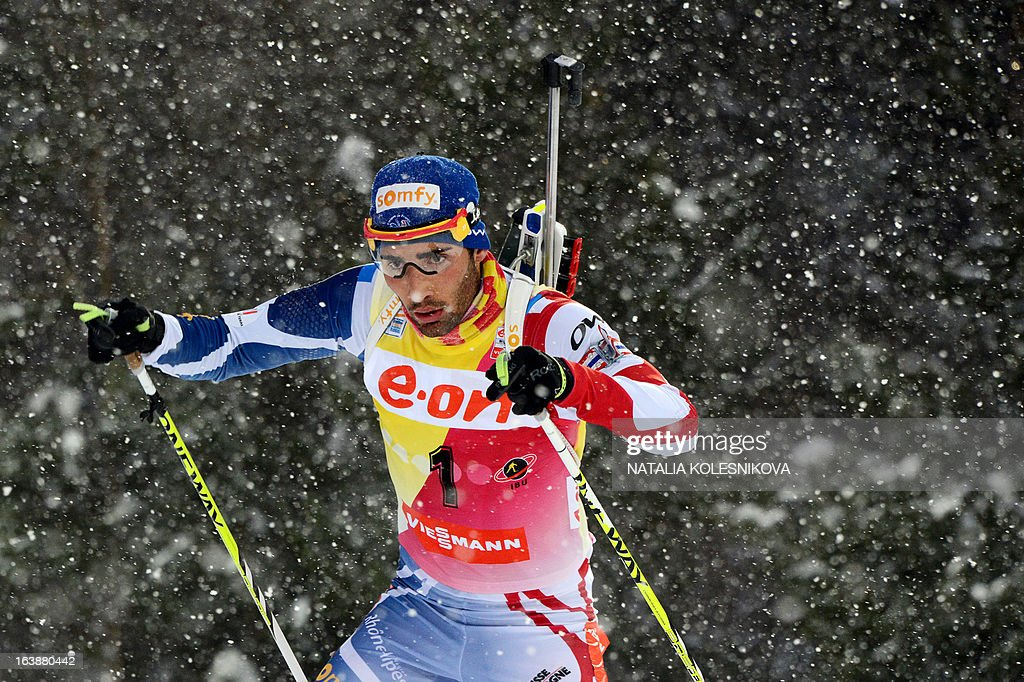 France's Martin Fourcade races to place first in the men's 15 km mass start event of the IBU Biathlon Word Cup in the Siberian city of Khanty-Mansiysk, on March 17, 2013. France's Martin Fourcade took the first place ahead of Austria's Dominik Landertinger and Norway's Emil Hegle Svendsen. AFP PHOTO/NATALIA KOLESNIKOVA