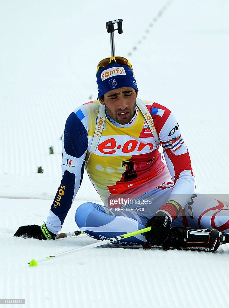 France's Martin Fourcade reacts after falling in front of the finish line during the pursuit men12,5 km as part of IBU Biathlon World Championships in Nove Mesto, Czech Republic, on February 10, 2013.Norway's Emil Hegle Svendsen won ahead of France's Martin Fourcade and Russia's Anton Shipulin.