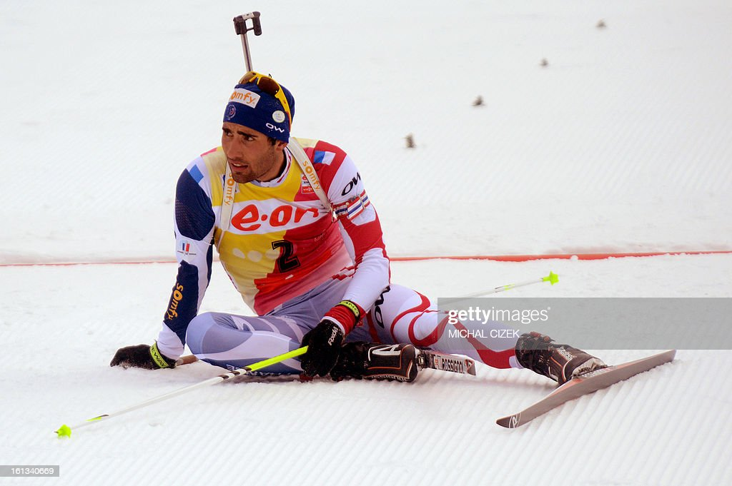 France's Martin Fourcade reacts after falling in front of the finish line during the pursuit men12,5 km as part of IBU Biathlon World Championships in Nove Mesto, Czech Republic, on February 10, 2013.Norway's Emil Hegle Svendsen won ahead of France's Martin Fourcade and Russia's Anton Shipulin. AFP PHOTO/MICHAL CIZEK