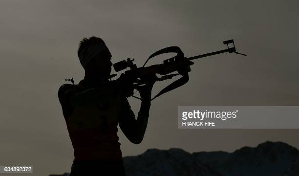 TOPSHOT France's Martin Fourcade shoots during Men's 125 km pursuit race during the 2017 IBU Biathlon World Championships in Hochfilzen on February...
