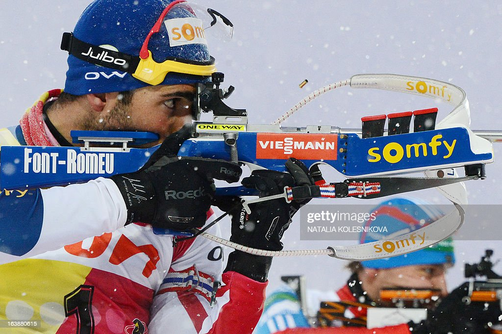 France's Martin Fourcade shoots during the men's 15 km mass start event of the IBU Biathlon Word Cup in the Siberian city of Khanty-Mansiysk, on March 17, 2013. France's Martin Fourcade took first place ahead of Austria's Dominik Landertinger and Norway's Emil Hegle Svendsen.