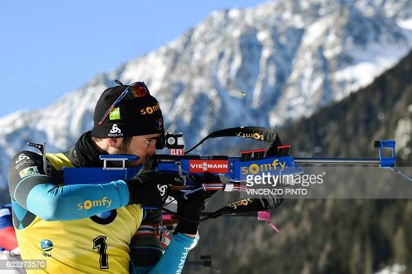 TOPSHOT France's Martin Fourcade shoots during the men's 15 km mass start competition of the IBU Biathlon World Cup in Anterselva on January 22 2017...