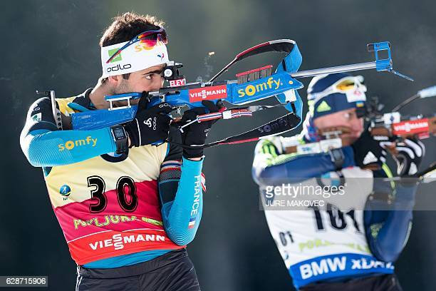 TOPSHOT France's Martin Fourcade warms up at the shooting range prior to the start of the Men's 10 km sprint race at the IBU Biathlon World Cup in...