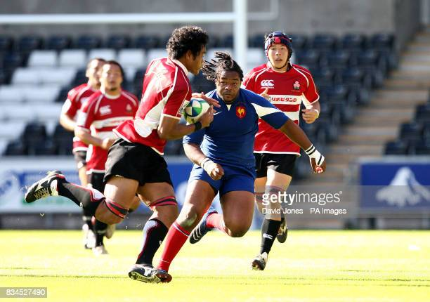France's Mathieu Bastareaud closes in on Japan's Pohiva Lotoahea for the Invesco Perpetual Junior Rugby World Cup match at Liberty Stadium Swansea