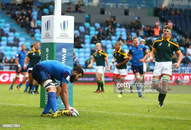 France's Mathieu Tanguy scores the first try of the match