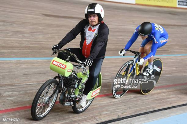 TOPSHOT France's Mathilde Gros rides behind the motorpacer during the Elite of the French championships on August 16 2017 at the velodrome of Hyeres...