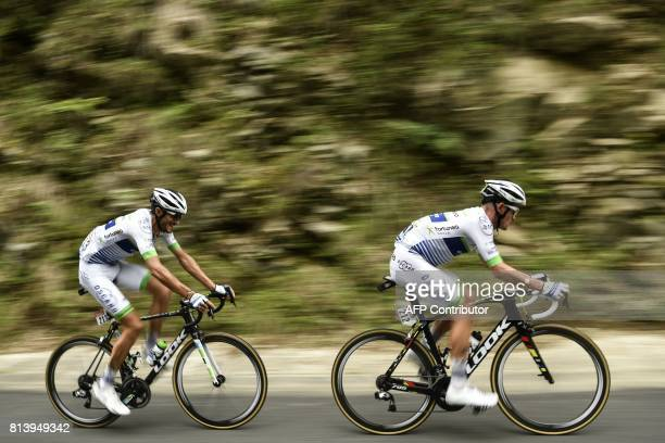 France's Maxime Bouet and France's Brice Feillu ride in a breakaway during the 2145 km twelfth stage of the 104th edition of the Tour de France...
