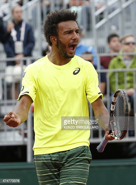 France's Maxime Hamou celebrates after winning a point against Poland's Jerzy Janowicz during the men's first round of the Roland Garros 2015 French...