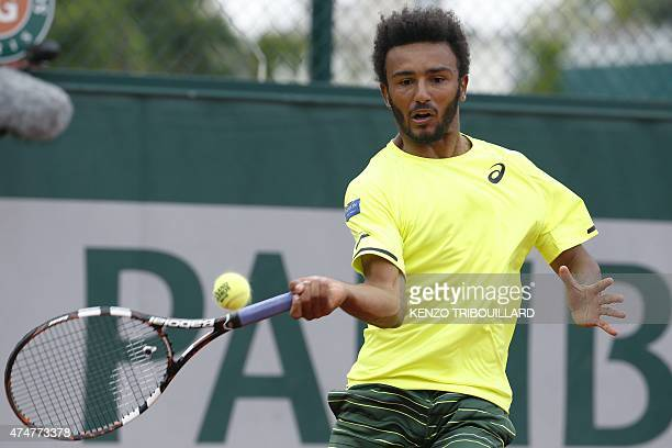 France's Maxime Hamou returns the ball to Poland's Jerzy Janowicz during the men's first round of the Roland Garros 2015 French Tennis Open in Paris...