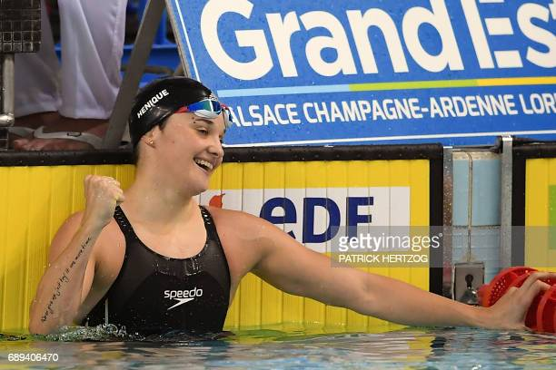 France's Melanie Henique reacts after winning the women's 50m butterfly final of the French swimming championship in Schiltigheim eastern France on...
