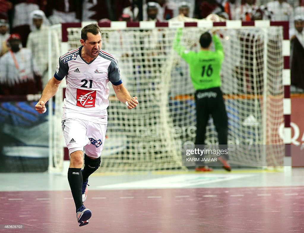 France's <a gi-track='captionPersonalityLinkClicked' href=/galleries/search?phrase=Michael+Guigou&family=editorial&specificpeople=791016 ng-click='$event.stopPropagation()'>Michael Guigou</a> celebrates a goal during the 24th Men's Handball World Championships final match between Qatar and France at the Lusail Multipurpose Hall in Doha on February 1, 2015. AFP PHOTO / MARWAN NAAMANI