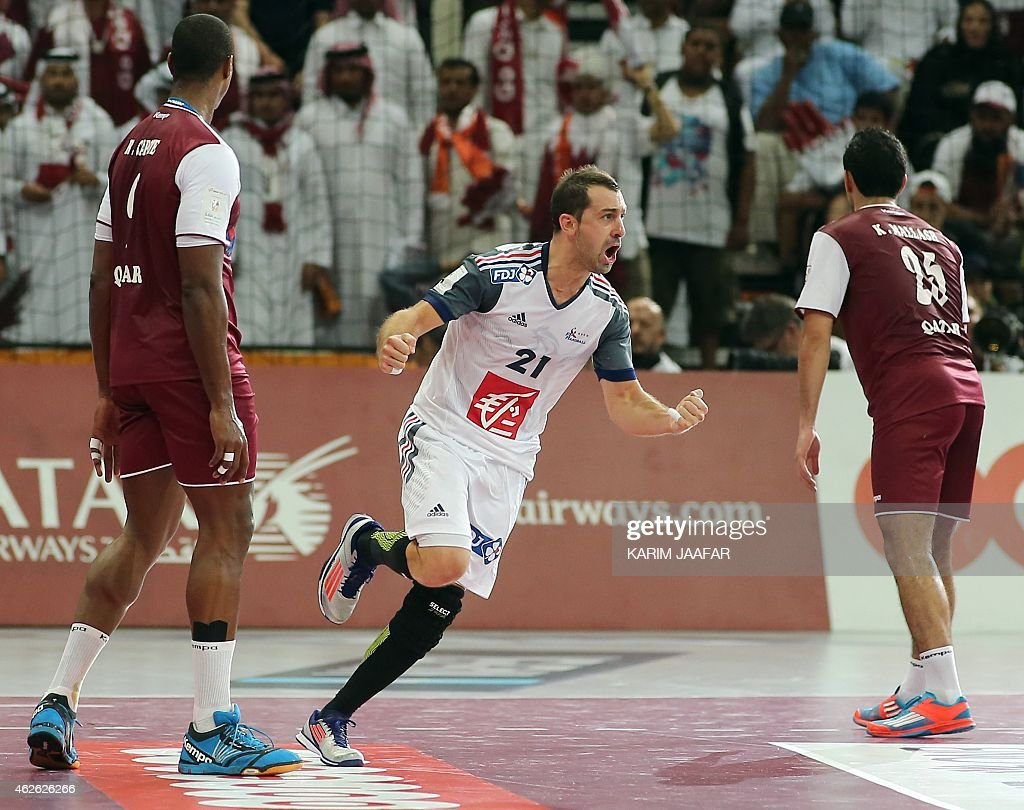 France's <a gi-track='captionPersonalityLinkClicked' href=/galleries/search?phrase=Michael+Guigou&family=editorial&specificpeople=791016 ng-click='$event.stopPropagation()'>Michael Guigou</a> (C) celebrates a goal during the 24th Men's Handball World Championships final match between France and Qatar at the Lusail Multipurpose Hall in Doha on February 1, 2015. AFP PHOTO / AL-WATAN DOHA / KARIM JAAFAR OUT==