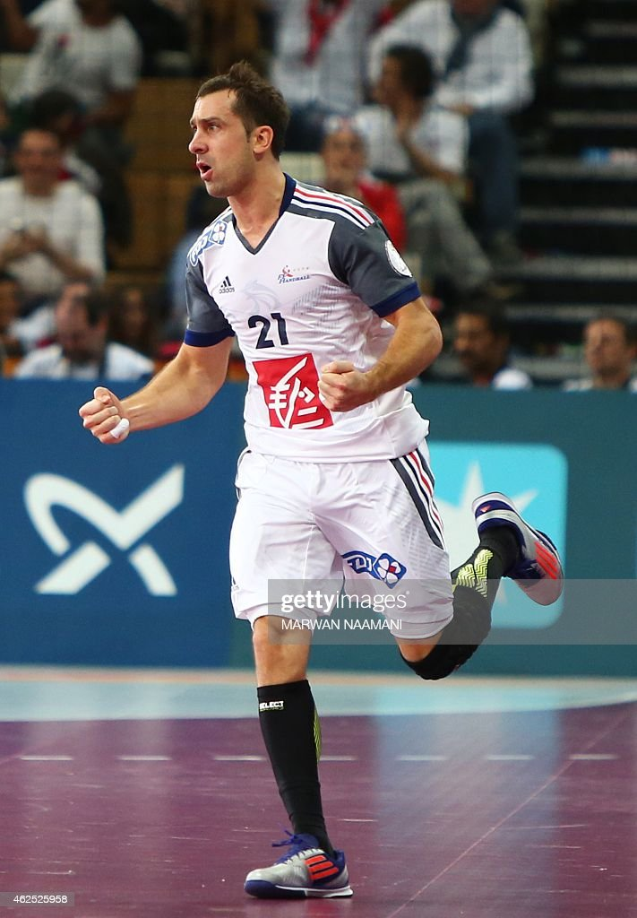 France's <a gi-track='captionPersonalityLinkClicked' href=/galleries/search?phrase=Michael+Guigou&family=editorial&specificpeople=791016 ng-click='$event.stopPropagation()'>Michael Guigou</a> celebrates after scoring a goal during the 24th Men's Handball World Championships semi-finals match between France and Spain at the Lusail Multipurpose Hall in Doha on January 30, 2015. AFP PHOTO / MARWAN NAAMANI