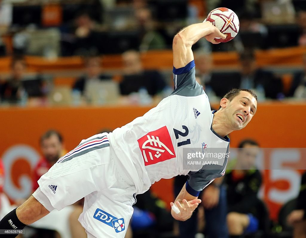 France's <a gi-track='captionPersonalityLinkClicked' href=/galleries/search?phrase=Michael+Guigou&family=editorial&specificpeople=791016 ng-click='$event.stopPropagation()'>Michael Guigou</a> takes a shot on goal during the 24th Men's Handball World Championships semi-finals match between Spain and France at the Lusail Multipurpose Hall in Doha on January 30, 2015. AFP PHOTO / AL-WATAN DOHA / KARIM JAAFAR OUT==
