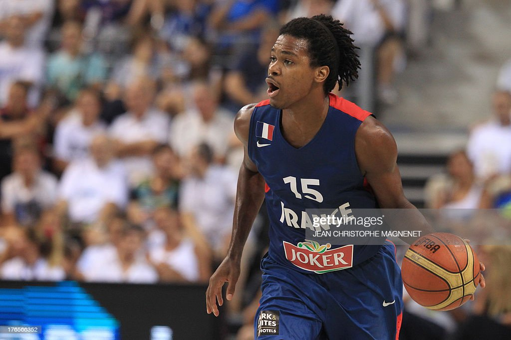 France's Mickael Gelabale dribbles the ball during a friendly basketball match between France and Serbia on August 15, 2013 in Antibes, southeastern France as part of the preparation for the 2013 EuroBasket in Slovenia.