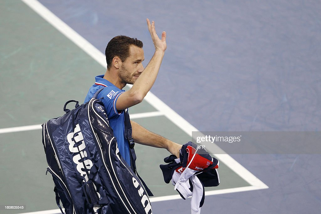 France's Mickael Llodra waves at the public as he leaves after his victory during the third singles match of the Davis Cup against Israel's Dudi Sela on February 3, 2013 at the Kindarena stadium in Rouen. Llodra won 6-3, 7-6.