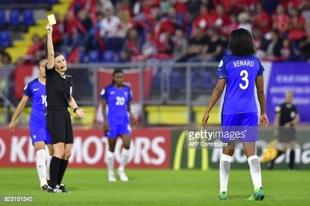 France's midfielder Abily Camille receives a yellow card from Hungarian referee Katalin Kulcsar during the UEFA Women's Euro 2017 football match...