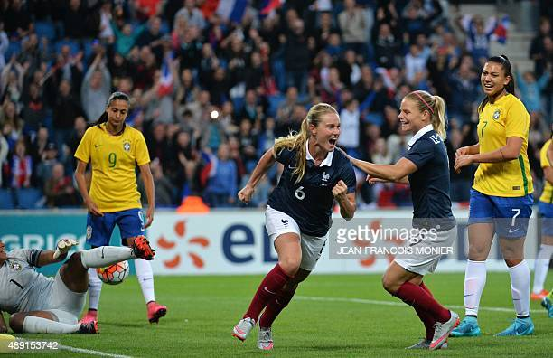 France's midfielder Amandine Henry celebrates after scoring during the Women's friendly football match France versus Brazil on September 19 at the...