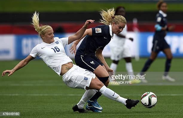France's midfielder Amandine Henry is tackled by England's midfielder Katie Chapman during a Group F match at the 2015 FIFA Women's World Cup between...