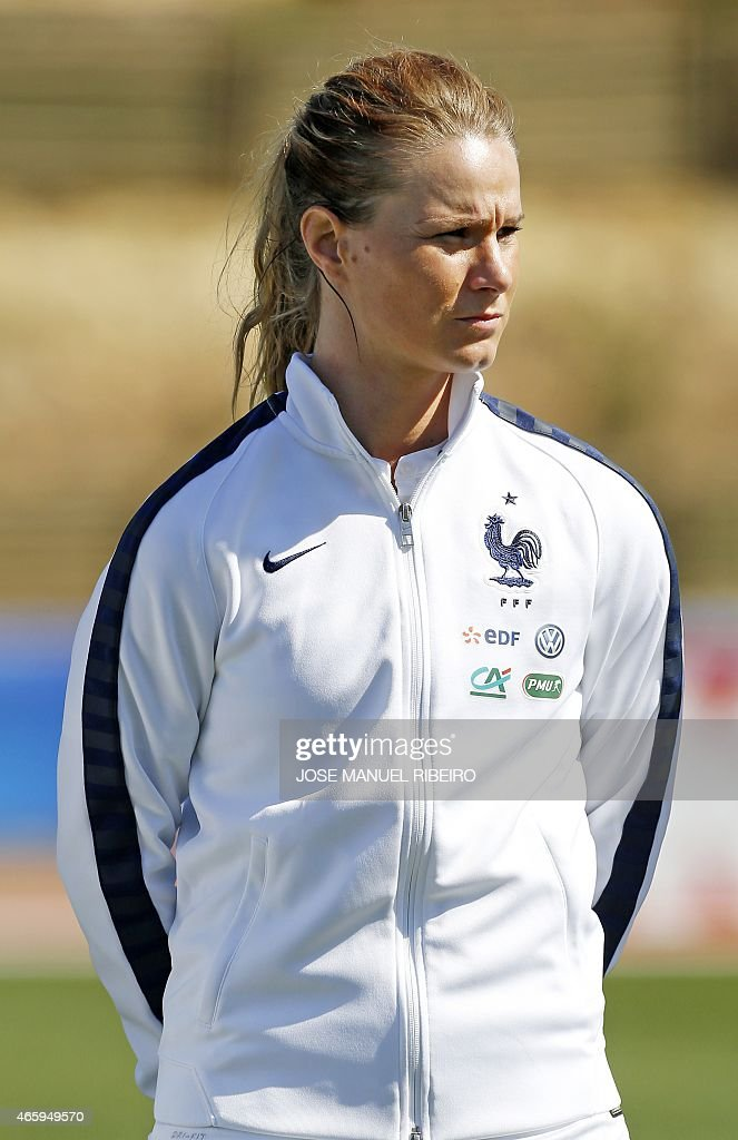 France's midfielder <a gi-track='captionPersonalityLinkClicked' href=/galleries/search?phrase=Amandine+Henry&family=editorial&specificpeople=4432019 ng-click='$event.stopPropagation()'>Amandine Henry</a> listens to the national anthem before the Algarve Cup football match Japan vs France at the Bela Vista stadium in Parchal on March 9, 2015.