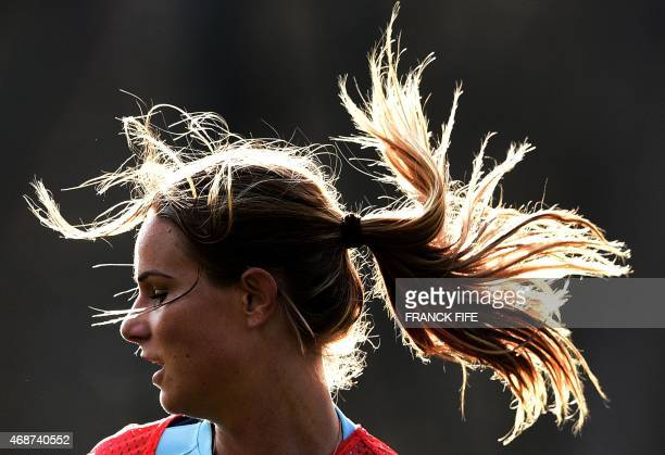 France's midfielder Amandine Henry takes part a training session in Clairefontaine en Yvelines southwest of Paris on April 6 ahead of the friendly...