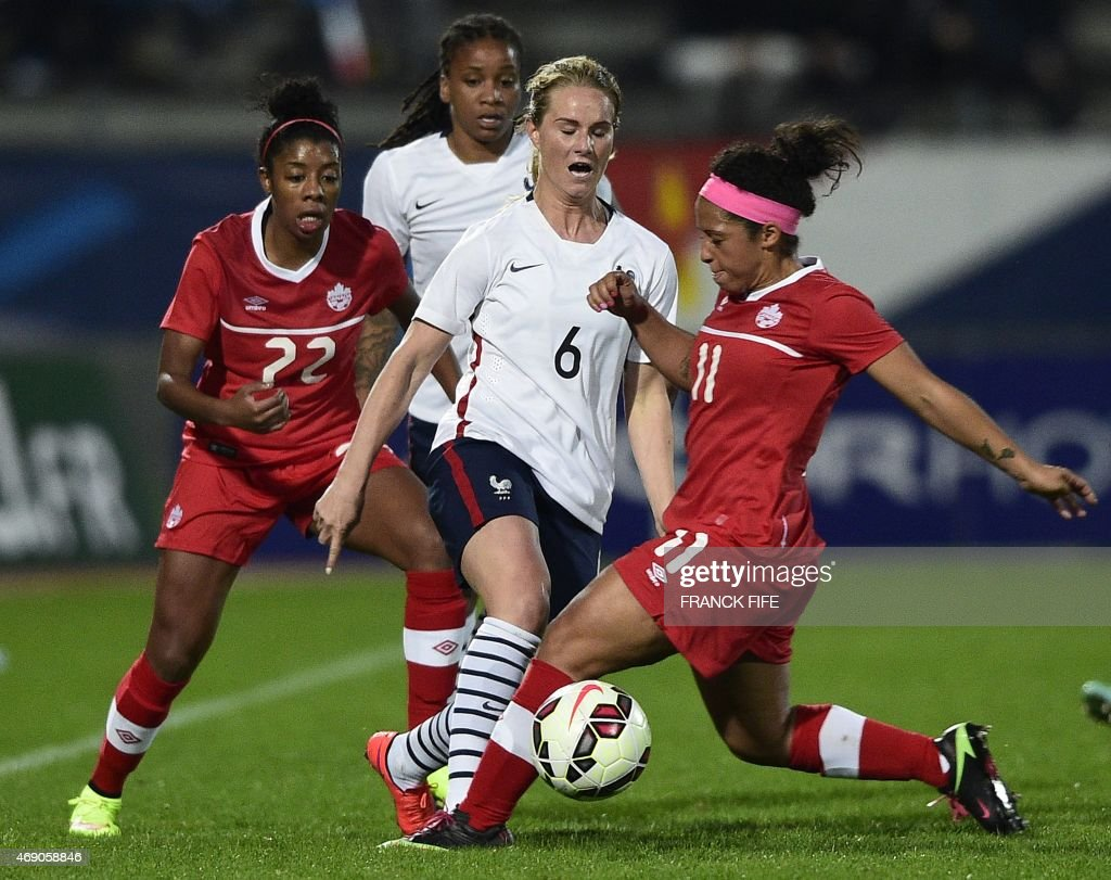 France's midfielder <a gi-track='captionPersonalityLinkClicked' href=/galleries/search?phrase=Amandine+Henry&family=editorial&specificpeople=4432019 ng-click='$event.stopPropagation()'>Amandine Henry</a> (C) vies with Canada's forward Ashley Lawrence (L) and Canada's midfielder <a gi-track='captionPersonalityLinkClicked' href=/galleries/search?phrase=Desiree+Scott&family=editorial&specificpeople=7888297 ng-click='$event.stopPropagation()'>Desiree Scott</a> during the friendly football match France vs Canada, on April 9, 2015 at the Stade Robert-Bobin stadium in Bondoufle, near Paris.