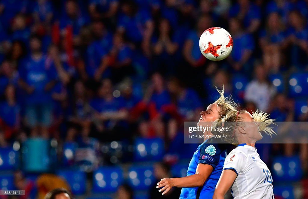 France's midfielder Amandine Henry (R) vies with Iceland's midfielder Dagny Brynjarsdottir during the UEFA Women's Euro 2017 football match between France and Iceland at Stadium Koning Wilhelm II in Tilburg on July 18, 2017. /