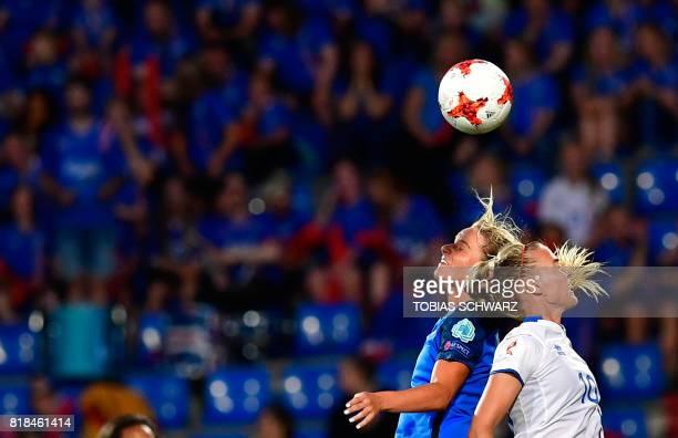 France's midfielder Amandine Henry vies with Iceland's midfielder Dagny Brynjarsdottir during the UEFA Women's Euro 2017 football match between...