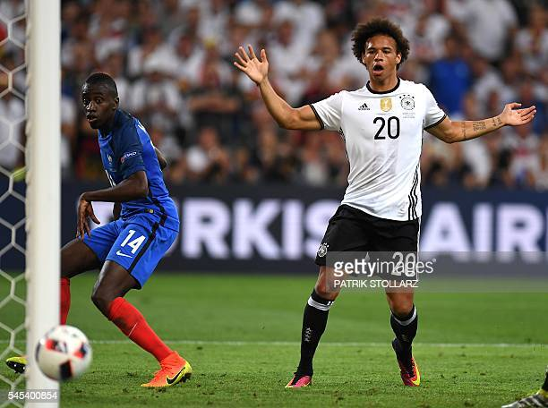 France's midfielder Blaise Matuidi and Germany's midfielder Leroy Sane eye the ball during the Euro 2016 semifinal football match between Germany and...