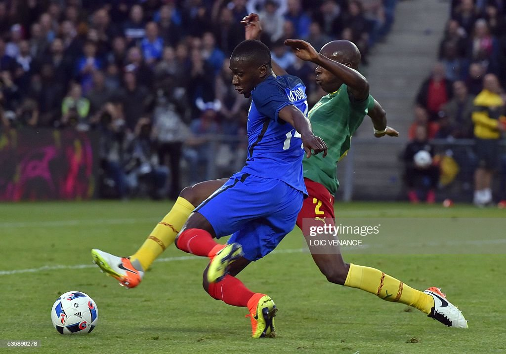 France's midfielder Blaise Matuidi (front) fights for the ball with Cameroon's defender Allan Nyom (rear) during the International friendly football match between France and Cameroon at the Beaujoire stadium, in Nantes, western France, on May 30, 2016 as part of the French team's preparation for the upcoming Euro 2016 European football championships. / AFP / LOIC