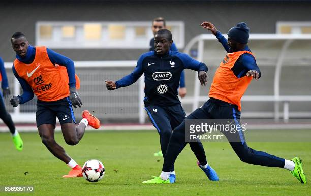France's midfielder Blaise Matuidi France's midfielder N'Golo Kante and France's midfielder Tiemoue Bakayoko take part in a training session in...