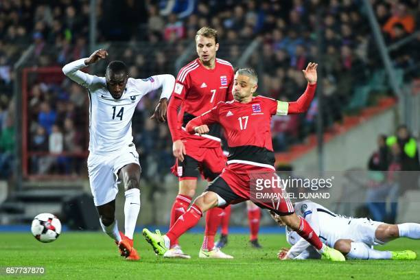 France's midfielder Blaise Matuidi outruns Luxembourg's midfielder Lars Gerson and defender Mario Mutsch during the FIFA World Cup 2018 qualifying...
