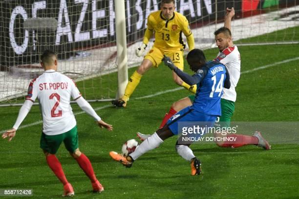 France's midfielder Blaise Matuidi scores his team's first goal past Bulgaria's goalkeeper Plamen IIiev during the FIFA World Cup 2018 qualifying...