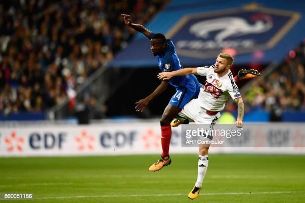 France's midfielder Blaise Matuidi vies with Belarus' midfielder Nikita Korzun during the FIFA World Cup 2018 qualification football match between...