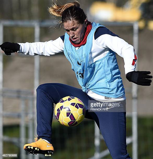 France's midfielder Camille Abily controls the ball during a training session in Clairefontaine en Yvelines on February 5 2015 ahead of the friendly...