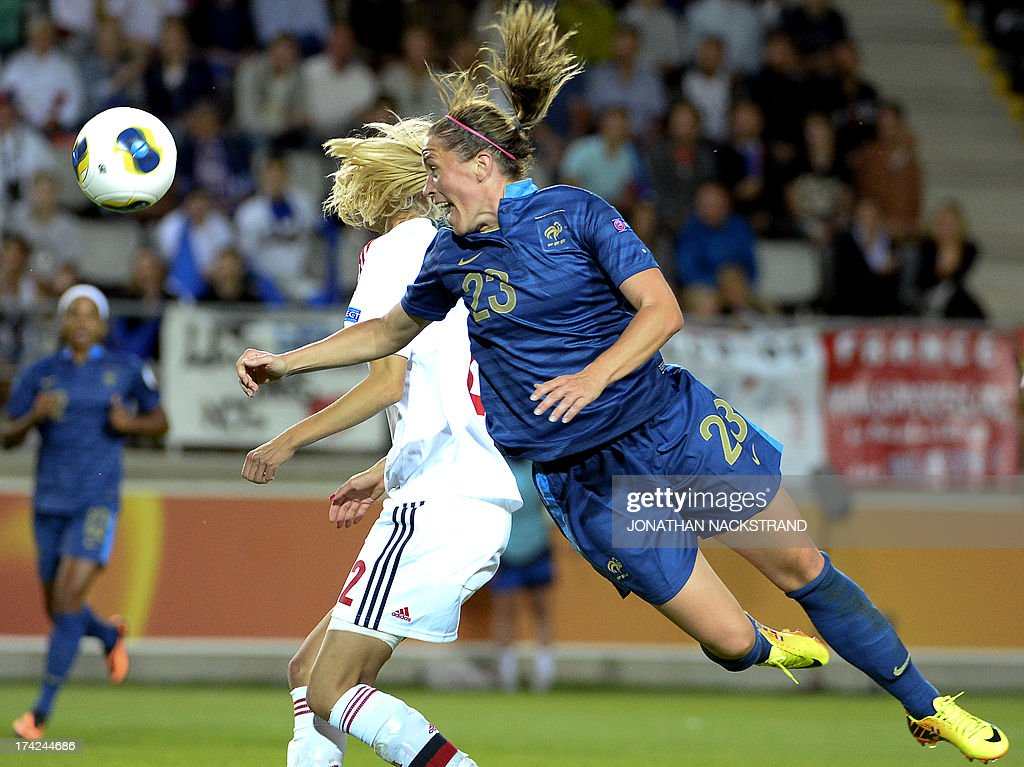 France's midfielder Camille Abily (R) heads the ball during the UEFA Women's European Championship Euro 2013 quarter final football match France vs Denmark on July 22, 2013 in Linkoping, Sweden.