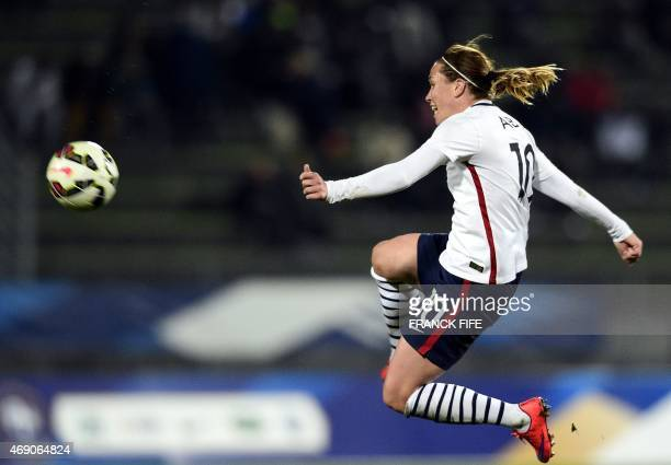 France's midfielder Camille Abily jumps for the ball during the friendly football match France vs Canada on April 9 2015 at the Stade RobertBobin...