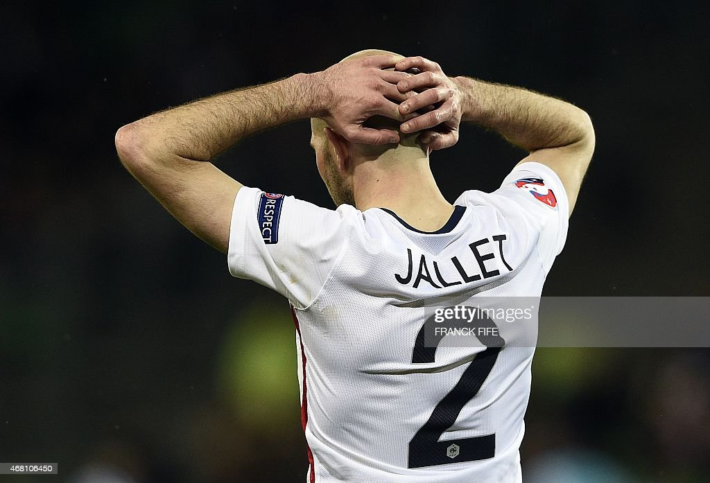 France's midfielder <a gi-track='captionPersonalityLinkClicked' href=/galleries/search?phrase=Christophe+Jallet&family=editorial&specificpeople=2264495 ng-click='$event.stopPropagation()'>Christophe Jallet</a> reacts during the friendly football match France vs Denmark, on March 29, 2015 at the Geoffroy-Guichard stadium in Saint-Etienne.