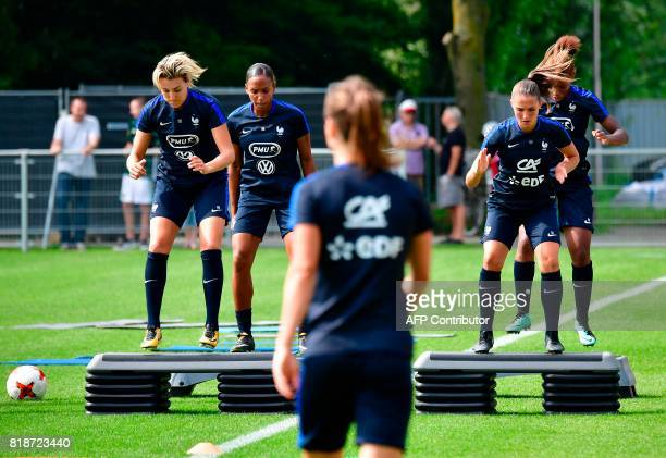 France's midfielder Claire Lavogez and France's defender Eve Perisset attend a training session in Zwijndrecht on July 19 during the UEFA Women's...