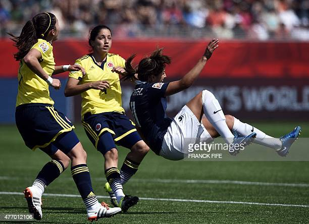 France's midfielder Claire Lavogez falls during a Group F match at the 2015 FIFA Women's World Cup between France and Colombia at Moncton Stadium New...