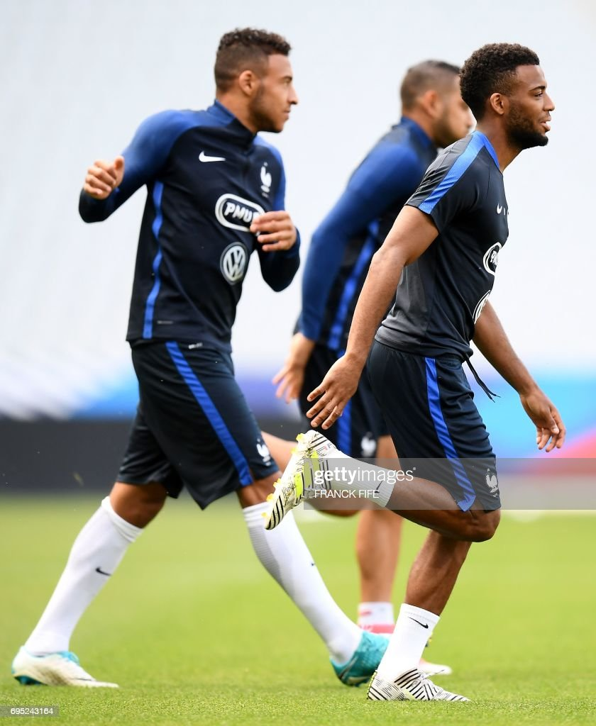 France s midfielder Corentin Tolisso L and France s forward