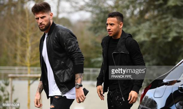 France's midfielder Corentin Tolisso and goalkeeper Benoit Costil arrive at the French national football team training base in Clairefontaine near...